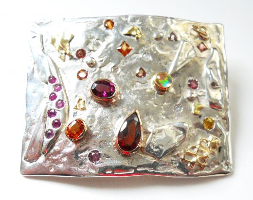 Sterling silver, garnets, sapphires, tourmalines, opal, 14k gold accents; private collection